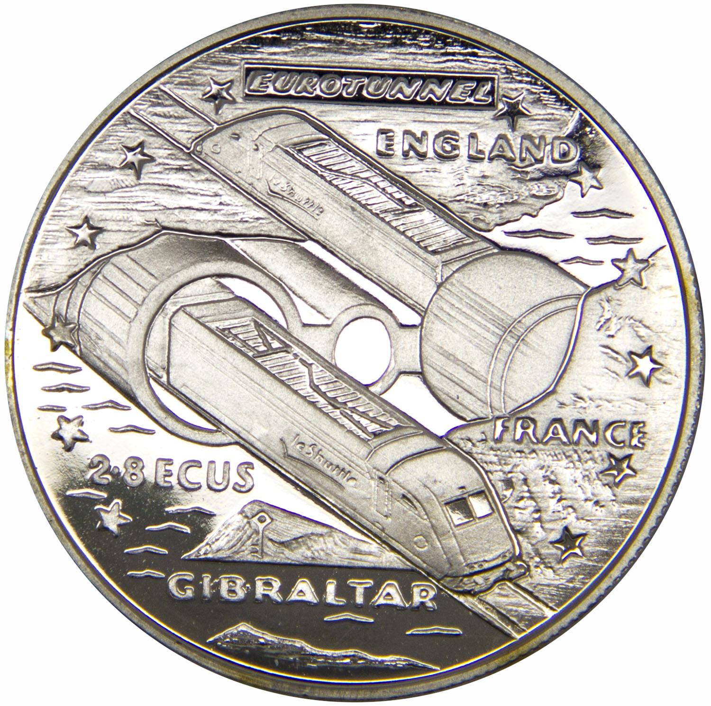 Монета номиналом 2,8 экю Евротоннель под Ла-Маншем. Гибралтар, 1993 год739Диаметр монеты: 40 мм Вес: 28 г. Материал: медь-никель Гурт: рубчатый