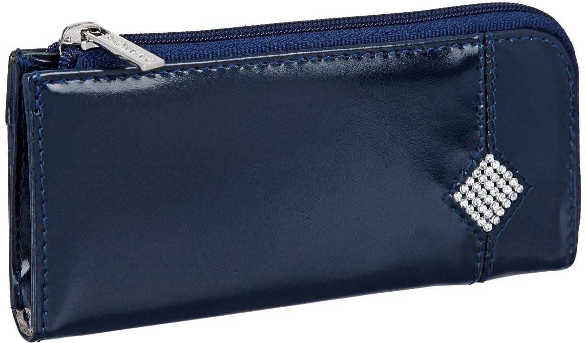 Ключница женская Dimanche Сапфир, цвет: темно-синий. 168168_синийКомпактная ключница Dimanche Сапфир изготовлена из натуральной кожи. Закрывается на пластиковую молнию. Внутренняя часть изделия исполнена из текстиля и дополнена кольцом для ключей. Лицевая сторона дополнена маленьким карманом на молнии и фигурой в виде ромба, инкрустированной стразами . Упакована в фирменную коробку. Стильный аксессуар прекрасно дополнит ваш образ и подчеркнет ваше отменное чувство стиля.