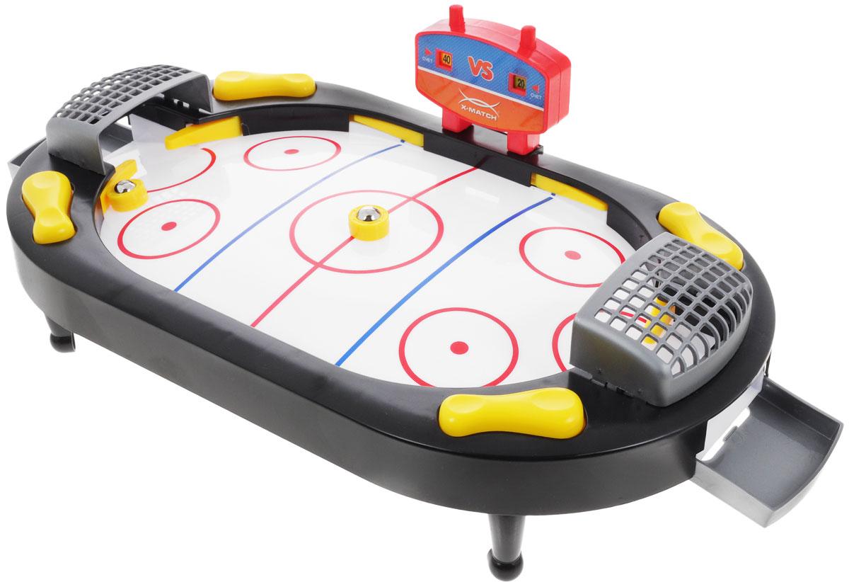 X-Match Настольная игра Хоккей87909Настольная игра Хоккей позволит вам весело провести время, устроив настоящее хоккейное соревнование на столе! В комплект входит игровое поле, счетчик, 2 ворот, 4 ножки для игрового поля, 2 контейнера для шайб, 2 шайбы. Чтобы начать игру, установите на игровое поле табло и ворота. Ведите счет игры, нажимая на кнопки счетчика очков. Для удара по шайбе и для отражения ударов противника нажимайте на кнопки на боковых панелях. Играть не только увлекательно, но и полезно! Игра помогает развить координацию движений, скорость реакции и внимание. Такой игровой набор станет прекрасным подарком и позволит приятно провести время в хорошей компании.