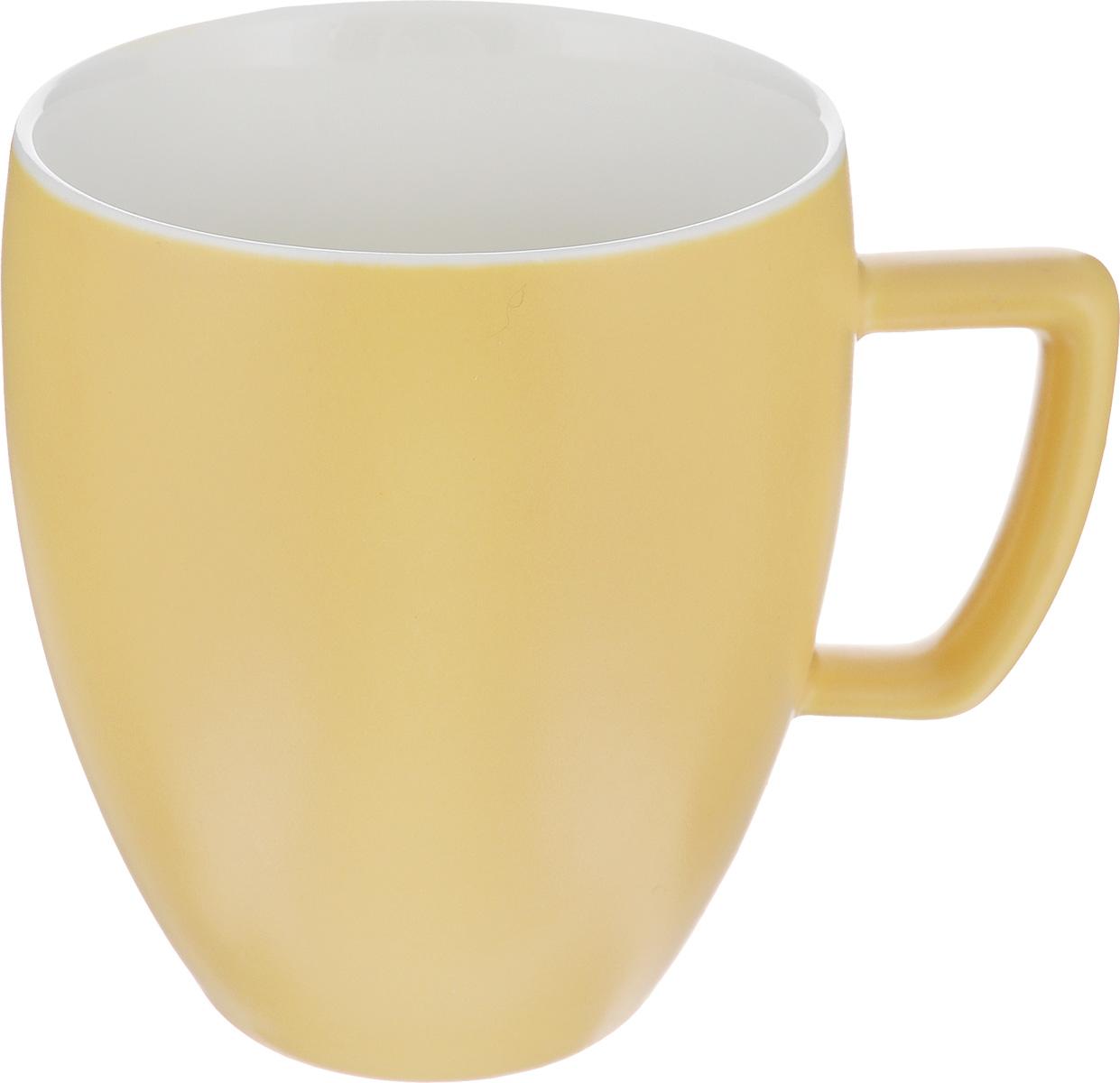 Кружка Tescoma Crema Tone, цвет: желтый, 300 мл387146_желтыйКружка Tescoma Crema Tone, изготовленная из высококачественного фарфора, прекрасно дополнит интерьер вашей кухни. Изящный дизайн кружки придется по вкусу и ценителям классики, и тем, кто предпочитает утонченность и изысканность. Кружка Tescoma Crema Tone станет хорошим подарком к любому празднику. Диаметр (по верхнему краю): 8 см. Высота: 10 см.