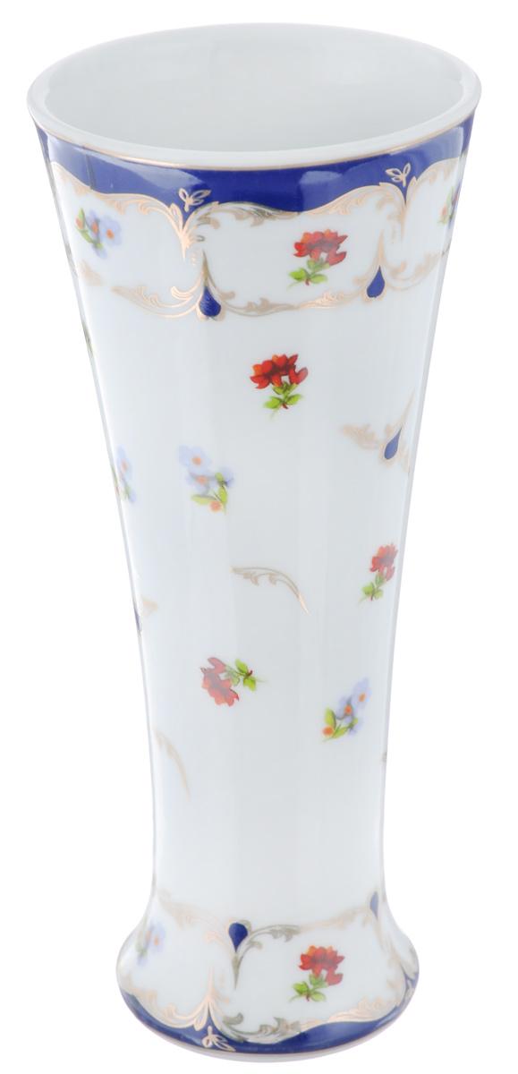 Ваза Elan Gallery Цветочек, высота 18 см503519Декоративная ваза Elan Gallery Цветочек украсит ваш интерьер и будет прекрасным подарком для ваших близких! Изделие выполнено из высококачественного фарфора и украшено ярким рисунком. Оригинальный дизайн наполнит ваш дом праздничным настроением. Такая ваза станет желанным подарком для ваших близких! Диаметр вазы по верхнему краю: 7,7 см. Диаметр дна: 5,5 см. Высота вазы: 18 см.