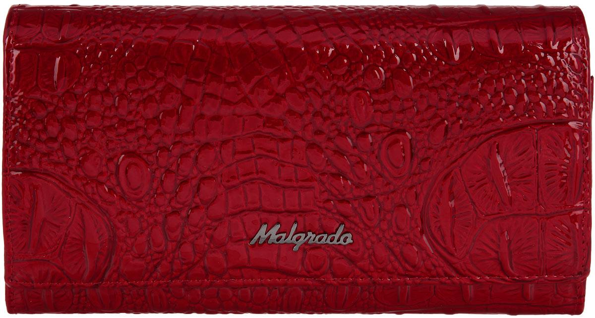 Кошелек женский Malgrado, цвет: красный. 64007-0170164007-01701 RedСтильный женский кошелек Malgrado выполнен из натуральной лакированной кожи с тиснением под рептилию и оформлен металлической фурнитурой с символикой бренда. Изделие закрывается клапаном на кнопку и содержит одно основное отделение. Внутри расположены четыре отделения для купюр, одно из которых закрывается клапаном на кнопку, отделение для монет, закрывающееся на рамочный замок, два накладных кармана, четыре кармана для пластиковых карт, карман с прозрачной вставкой из пластика. Изделие поставляется в фирменной упаковке. Кошелек Malgrado станет отличным подарком для человека, ценящего качественные и практичные вещи.