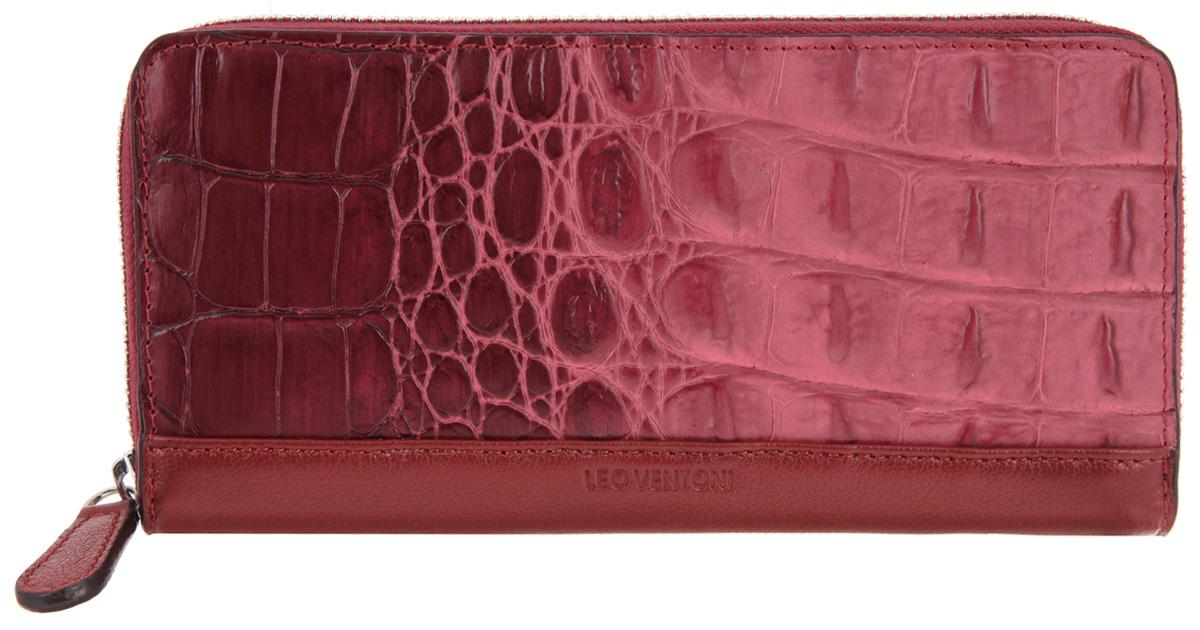 Кошелек женский Leo Ventoni, цвет: коричневый, бордовый. L330961L330961-bordoСтильный женский кошелек Leo Ventoni выполнен из натуральной кожи с тиснением под рептилию, оформлен металлической фурнитурой и символикой бренда. Изделие закрывается на молнию. Внутри расположены: три отделения для купюр, отделение для монет на молнии, два накладных кармана, девять накладных карманов для пластиковых карт, один из которых дополнен прозрачной вставкой из пластика. Изделие поставляется в фирменной упаковке. Кошелек Leo Ventoni станет отличным подарком для человека, ценящего качественные и практичные вещи.