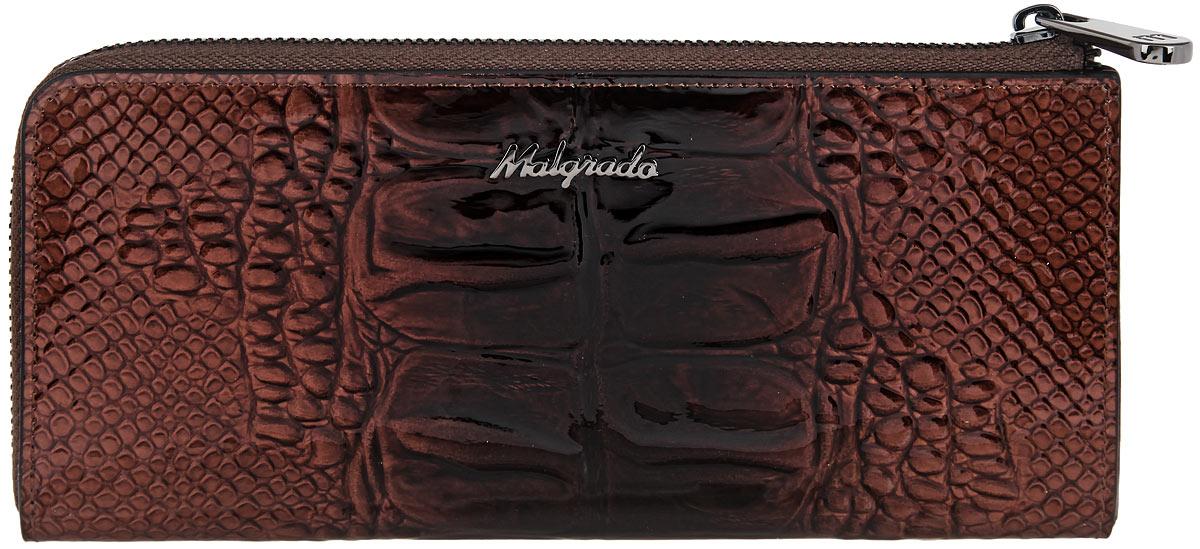 Кошелек женский Malgrado, цвет: коричневый. 76002-0440376002-04403 BrownСтильный женский кошелек Malgrado выполнен из натуральной лакированной кожи с тиснением под рептилию и оформлен металлической фурнитурой с символикой бренда. Изделие закрывается на молнию. Внутри расположены два отделения для купюр, отделение для монет на молнии, два накладных кармана, двенадцать накладных карманов для пластиковых карт. Снаружи, в тыльной стенке кошелька, расположен врезной карман на молнии. КИзделие поставляется в фирменной упаковке. Кошелек Malgrado станет отличным подарком для человека, ценящего качественные и практичные вещи.