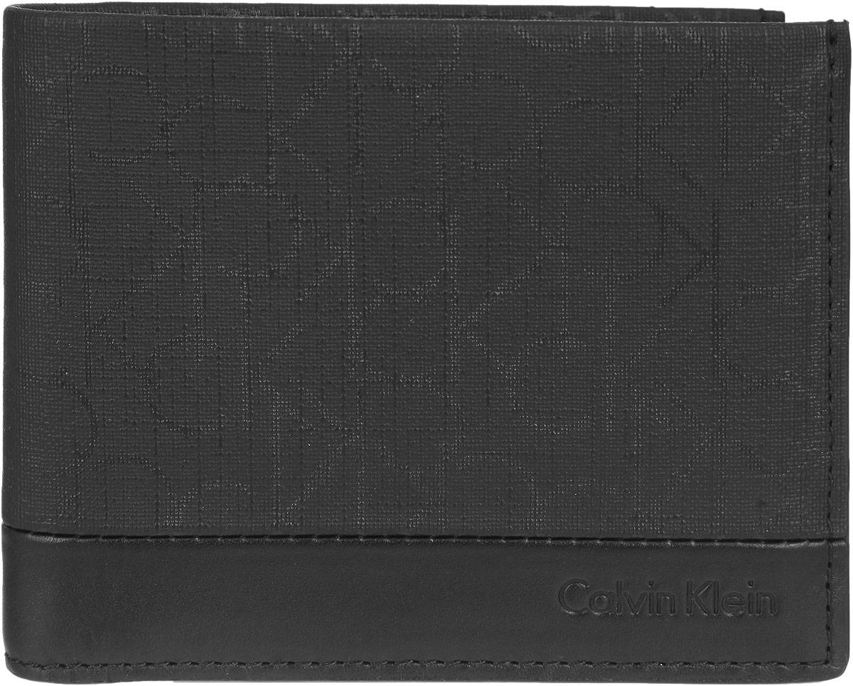 Кошелек мужской Calvin Klein Jeans, цвет: черный. K50K500473K50K500473Мужской кошелек Calvin Klein Jeans, изготовленный из ПВХ и искусственной кожи, оформлен фирменным принтом и с лицевой стороны тиснением с названием бренда. Изделие раскладывается пополам. Внутри находится два отделения для купюр, четыре потайных кармана и восемь кармашков для визиток и пластиковых карт. Изделие упаковано в фирменную коробку. Стильный кошелек не только дополнит ваш образ, но и будет незаменимым аксессуаром.