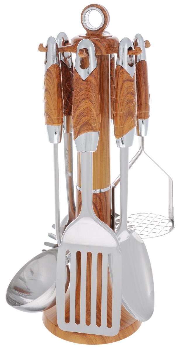 Набор кухонных принадлежностей Mayer & Boch, цвет: металлик, коричневый, 7 предметов. 2242922429Набор кухонных принадлежностей Mayer & Boch станет незаменимым помощником на кухне, поскольку в набор входят самые необходимые кухонные аксессуары: ложка для спагетти, половник, шумовка, ложка кулинарная, лопатка с прорезями, картофелемялка. Предметы набора изготовлены из нержавеющей стали и размещены на элегантной пластиковой подставке. Ручки изделий, выполненные из пластика, оснащены отверстием для подвешивания на крючок. Пластиковые части изделия имитируют дерево. Размер подставки: 11 см х 11 см х 39 см. Длина половника: 33 см. Размер рабочей поверхности половника: 8,5 см х 9 см. Длина лопатки с прорезями: 32 см. Размер рабочей поверхности лопатки с прорезями: 10 см х 7,5 см. Длина ложки: 32 см. Размер рабочей поверхности ложки: 10 см х 7 см. Длина ложки для спагетти: 29 см. Размер рабочей поверхности ложки для спагетти: 6 см х 8 см. Длина шумовки: 32 см. Размер рабочей поверхности шумовки: 11 см х 11 см. Длина...