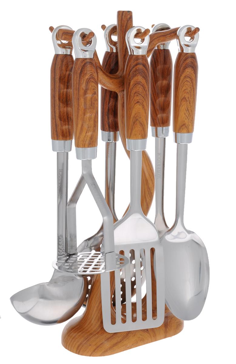 Набор кухонных принадлежностей Mayer & Boch, цвет: металлик, коричневый, 7 предметов. 2242822428Набор кухонных принадлежностей Mayer & Boch станет незаменимым помощником на кухне, поскольку в набор входят самые необходимые кухонные аксессуары: ложка для спагетти, половник, шумовка, ложка кулинарная, лопатка с прорезями, картофелемялка. Предметы набора изготовлены из нержавеющей стали и размещены на элегантной пластиковой подставке. Ручки изделий, выполненные из пластика, оснащены отверстием для подвешивания на крючок. Пластиковые части изделия имитируют дерево. Размер подставки: 16 см х 8 см х 38 см. Длина половника: 33 см. Размер рабочей поверхности половника: 9 см х 9 см. Длина лопатки с прорезями: 33 см. Размер рабочей поверхности лопатки с прорезями: 10 см х 7,5 см. Длина ложки: 3 см. Размер рабочей поверхности ложки: 10 см х 7,5 см. Длина ложки для спагетти: 31 см. Размер рабочей поверхности ложки для спагетти: 6 см х 8 см. Длина шумовки: 34 см. Размер рабочей поверхности шумовки: 11 см х 11...