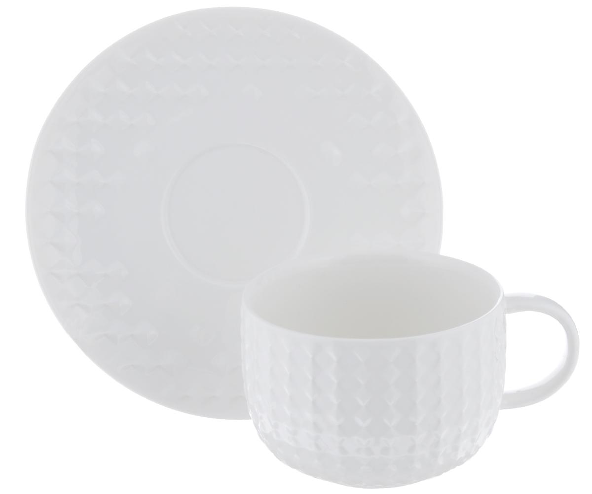 Чайная пара Walmer Sapphire, цвет: белый, 2 предметаW07470025Чайная пара Walmer Sapphire состоит из чашки и блюдца, изготовленных из фарфора белого цвета и декорированных необычным рельефом. Чайная пара Walmer Sapphire украсит ваш кухонный стол, а также станет замечательным подарком к любому празднику. Не применять абразивные чистящие средства. Объем чашки: 250 мл. Диаметр чашки по верхнему краю: 9 см. Диаметр основания: 5 см. Высота чашки: 6,5 см. Диаметр блюдца: 15,5 см.