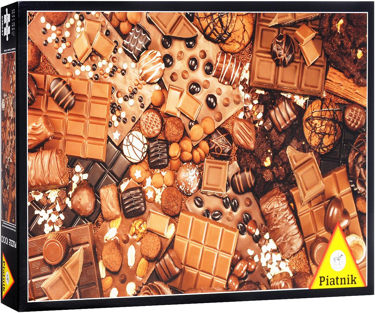 Piatnik Пазл Шоколад538247Пазл Piatnik Шоколад станет хорошим подарком всем любителям пазлов и головоломок! Собрав этот пазл, включающий в себя 1000 элементов, вы получите красочную картину с изображением разных видов шоколада. Чтобы справиться с задачей вам будет необходимо приложить немалую долю внимания и терпения. Вы сразу поймете, подходят ли детали друг к другу, за счет уникальной формы каждого элемента. А качественный материал не позволит картине потускнеть с течением времени. Собирание пазла - это увлекательное, познавательное занятие, а также прекрасное времяпрепровождение для всей семьи. Размер готового пазла: 68 см х 48 см.