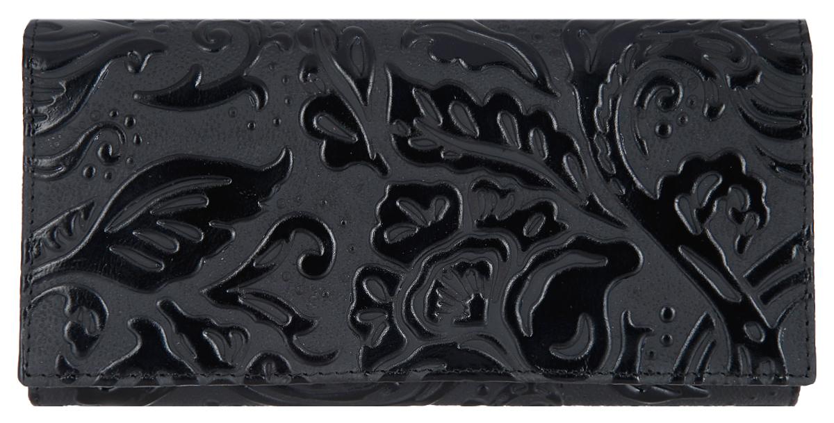 Портмоне женское Dimanche Elite. Арабеска, цвет: черный. 991/1991/1Стильное женское портмоне Dimanche Elite. Арабеска выполнено из натуральной кожи с рельефным рисунком. Внутри находятся два отделения для купюр, одно из которых разделено пополам карманом-средником на застежке-молнии, шесть кармашков для визиток и пластиковых карт, один из которых с прозрачным окошечком и потайной карман. Портмоне закрывается клапаном на кнопку. Снаружи, на передней стенке под клапаном расположен карман для чеков и два кармашка для визиток и пластиковых карт. На задней стенке предусмотрен карман для мелких бумаг. Изделие упаковано в фирменную коробку. Такое портмоне станет замечательным подарком человеку, ценящему качественные и практичные вещи.