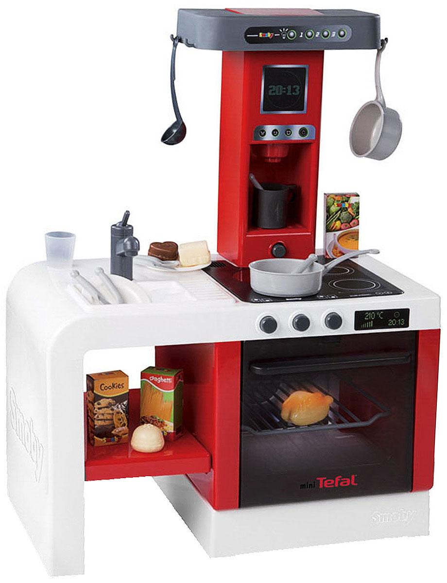 Smoby Игровой набор Кухня MiniTefal, 22 предмета24114Если ваш ребенок любит помогать маме на кухне, играть с посудой, варить и жарить, но вам приходится ограничивать его в игре с бьющимися предметами кухонной утвари, то эта детская кухня создана специально для юного поваренка. Игровой набор Smoby Кухня MiniTefal это компактная кухня с многими электронными функциями. Благодаря своим эргономичным размерам, она нуждается в минимальном пространстве для размещения в детской. Все как в настоящей кухне - мойка с краном, духовой шкаф с подсветкой, варочная панель, имитирующая звуки приготовления пищи, кофеварка с реалистичными звуками. В набор входят аксессуары для игры: два сотейника, поварешка, кружка, два стакана, две тарелки, две ложки, две вилки, два ножа и продукты. С такой кухней ваш ребенок сможет устроить для своих игрушек удивительный обед. Порадуйте его таким замечательным подарком! Характеристики: Материал: пластик, картон. Размер кухни: 47 см х 28 см х 61 см. Размер...