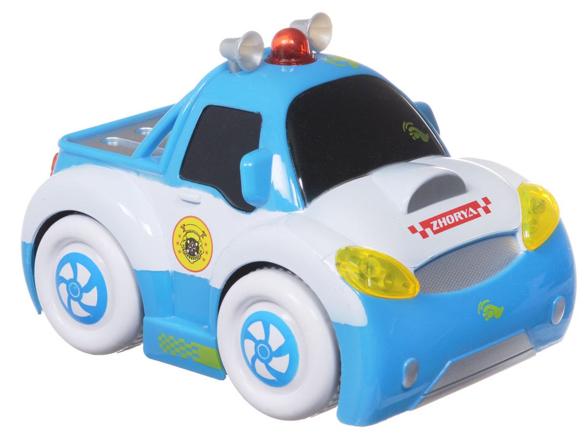 Zhorya Машинка c сенсорным управлением Автомалыш цвет белый голубойХ75541_белый/голубойМашинка c сенсорным управлением Zhorya станет отличным подарком для вашего малыша. Модель изготовлена из высококачественных ударопрочных материалов, оснащена звуковыми и световыми эффектами. При прикосновении к машинке звучат забавные фразы и детские песенки, включаются фары. Для работы игрушки необходимы 3 батарейки типа АА (не входят в комплект).