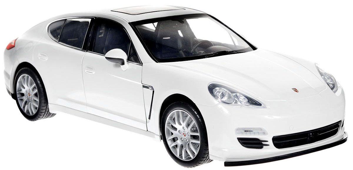 Welly Радиоуправляемая модель Porsche Panamera S цвет белый82005Радиоуправляемая модель Porsche Panamera S со световыми эффектами, являющаяся точной копией настоящего автомобиля - отличный подарок не только ребенку, но и взрослому. Автомобиль изготовлен из современных ударопрочных материалов и обладает высокой стабильностью движения, что позволяет полностью контролировать его процесс, управляя без суеты и страха сломать игрушку. Основные направления движения автомобиля: вперед-назад-влево-вправо. Движение вперед и назад сопровождается сигнальными световыми эффектами фар. Двери автомобиля открываются, внутри - подробная имитация салона. Двери также можно открыть кнопкой на пульте управления. В комплект входят автомобиль, пульт управления и инструкция на английском языке. Автомобиль работает от 6 батарей типа АА, пульт управления - от 4 батарей типа АА (не входят в комплект).