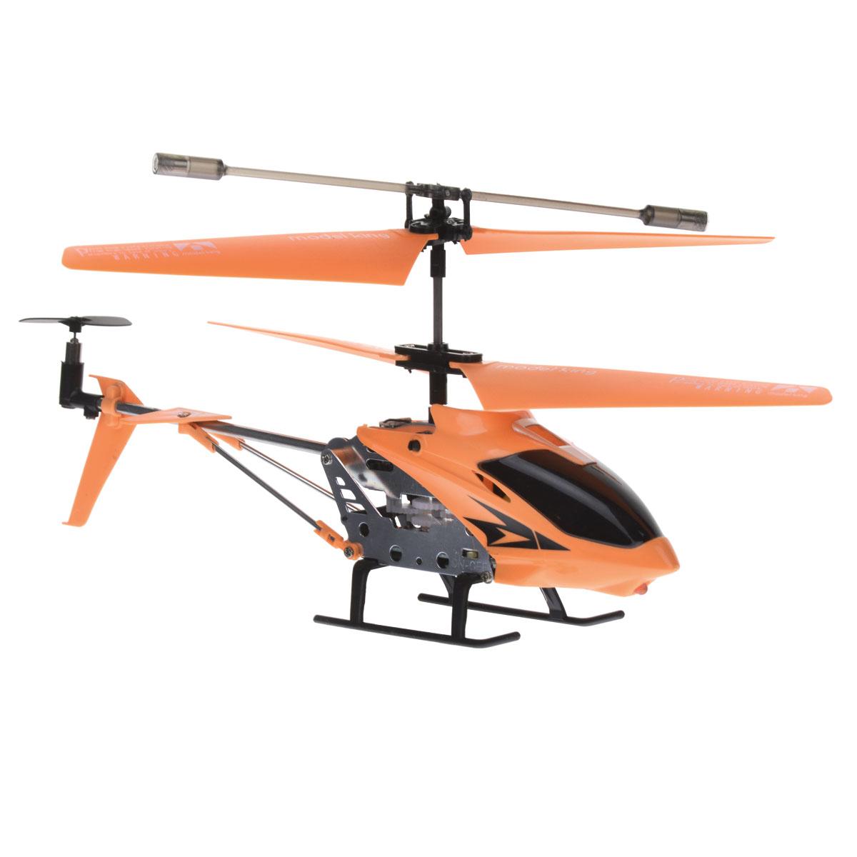 Junfa Toys Вертолет на радиоуправлении Model King цвет оранжевый33008-1оранжевыйВертолет радиоуправляемый с гироскопом, который позволяет ему плавно парить в воздухе. Он может передвигаться вправо/влево, вверх/вниз, вперед/назад. Небольшой размер и маленький вес обеспечивают маневренность и скорость. У вертолета металлический прочный каркас. Радиоуправляемый металлический вертолет на радиоуправлении Junfa Toys Model King понравится любому ребенку. 3,5-канальный вертолет с гироскопом будет плавно парить в воздухе и зависать по командам с пульта управления. Благодаря пульту вертолет может перемещаться назад и вперед, вверх и вниз, а также устремляться в левую и правую сторону. Маленький вес вертолета и небольшой размер обеспечивают скорость и маневренность . У вертолета прочный металлический каркас. В передней части вертолета имеется светодиод, который попеременно горит синим и красным цветом. Очень эффектно смотрится в сумеречное время.