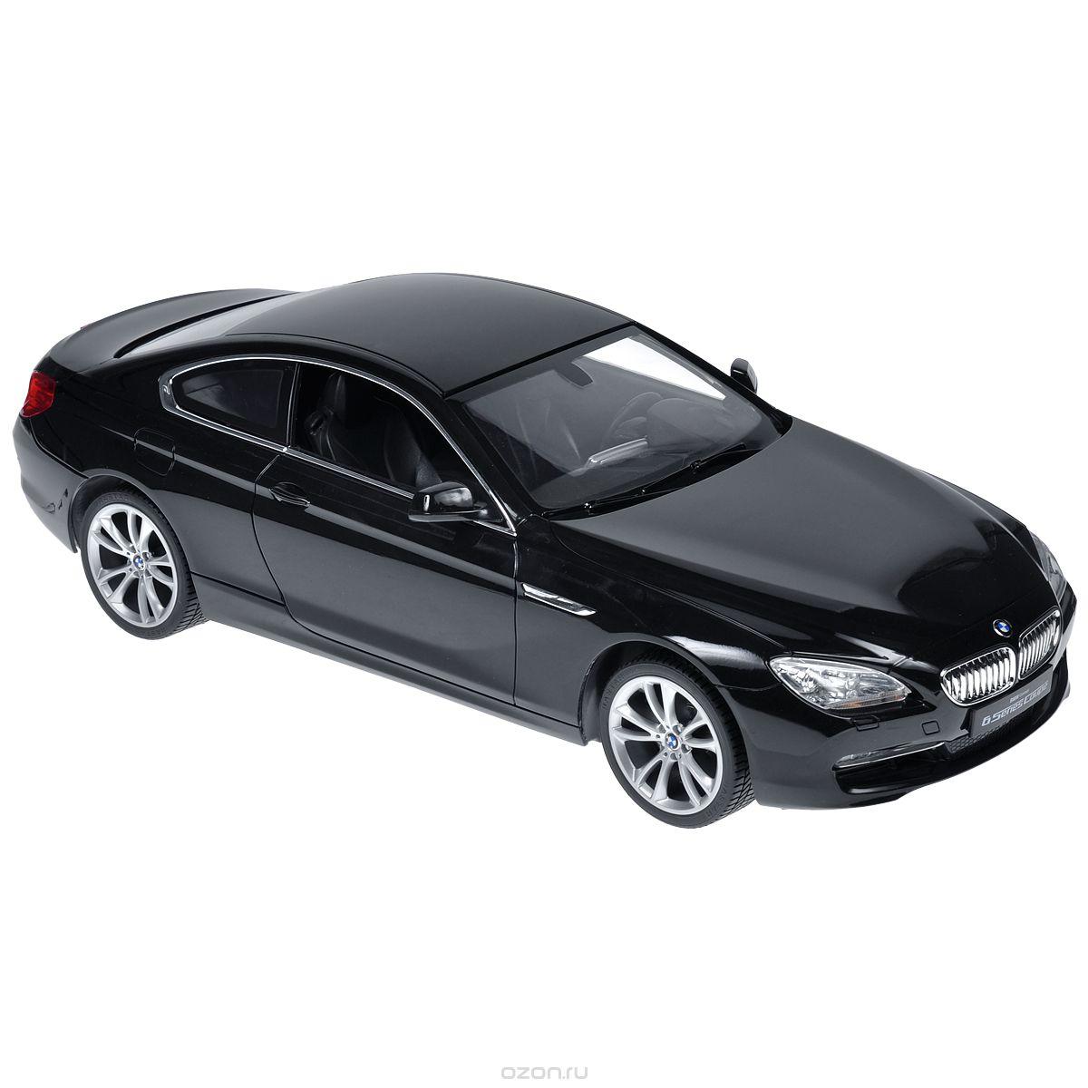 Rastar Радиоуправляемая модель BMW 6S цвет черный52300Радиоуправляемая модель Rastar BMW 6S со световыми эффектами, являющаяся точной копией настоящего автомобиля, - отличный подарок не только ребенку, но и взрослому. Автомобиль изготовлен из современных прочных материалов и обладает высокой стабильностью движения, что позволяет полностью контролировать его процесс, управляя без суеты и страха сломать игрушку. Основные направления движения автомобиля: вперед-назад-влево-вправо. Движение вперед и назад сопровождается сигнальными световыми эффектами фар. Прорезиненные колеса обеспечивают превосходное сцепление с любой поверхностью пола. Автомобиль работает от аккумулятора Ni-Cd AA 600 mAh 9.6V, заряжающегося от электрической сети. В комплект входят автомобиль, пульт управления, аккумулятор, зарядное устройство и инструкция на русском языке. Автомобиль работает от аккумулятора Ni-Cd AA 600 mAh 9.6V (входит в комплект), пульт управления - от 1 батарейки 9V 6F22 (не входит в комплект).