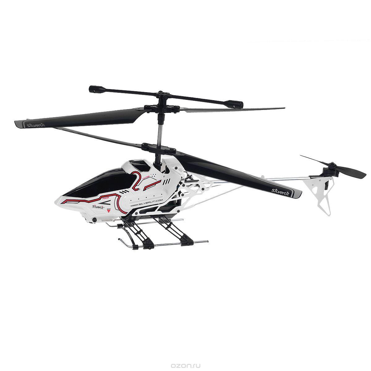 Silverlit Вертолет на радиоуправлении Sky Eye84602Радиоуправляемая модель Silverlit Вертолет Sky Eye со световыми эффектами привлечет внимание не только ребенка, но и взрослого, и станет отличным подарком любителю воздушной техники. Вертолет оснащен уникальной системой винта, позволяющей вертолету плавно подниматься, а также встроенным гироскопом, который поможет скорректировать и устранить нежелательные вращения корпуса вертолета, благодаря чему сохранится высокая устойчивость полета. Каркас вертолета выполнен из пластика с использованием металла. Вертолет имеет трехканальное дистанционное управление, с помощью пульта управления можно менять скорость полета, а также проделывать фигуры высшего пилотажа, в том числе зависание в воздухе. Вертолет оснащен видеокамерой, которая передает изображение непосредственно на пульт управления, что позволит вам еще больше насладиться полетом! Есть разъем под microSD-карту. Модель идеально подходит для игры как внутри помещения, так и на улице. В комплект входит радиоуправляемый...