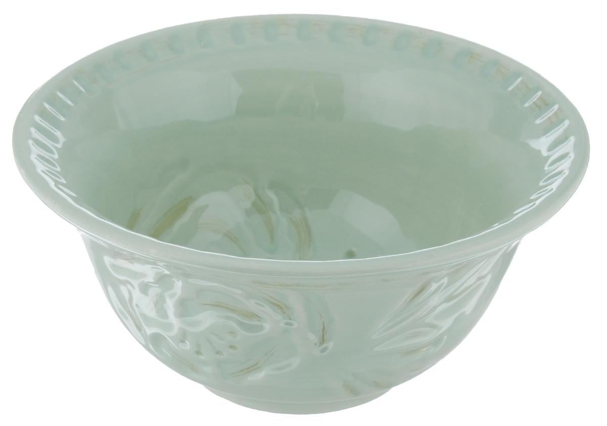 Тарелка суповая Fitz and Floyd Тулуза, цвет: зеленый, диаметр 18 см20-498_зеленыйТарелка Fitz and Floyd Тулуза изготовлена из высококачественной керамики и декорировано изящным узором. Оригинальное изделие украсит сервировку вашего стола и подчеркнет прекрасный вкус хозяйки, а также станет отличным подарком. Можно мыть в посудомоечной машине и использовать в микроволновой печи. Диаметр тарелки (по верхнему краю): 18 см. Высота тарелки: 8,5 см.