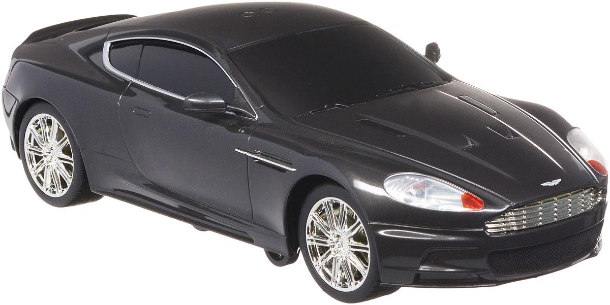 Toystate Радиоуправляемая модель Aston Martin DBS62060TS_черныйРадиоуправляемая модель Toystate Aston Martin DBS - это миниатюрная копия автомобиля Джеймса Бонда, которая управляется дистанционно. Машинка даст малышу почувствовать себя в роли популярного шпиона британской спецслужбы MI-6. Модель изготовлена из прочного пластика, оснащена световыми и звуковыми эффектами при движении и отлично подойдет для игры как дома, так и на улице в песочнице, при этом готова подарить вашему малышу отличное времяпрепровождение и массу удовольствия. Движения: вперед, назад, вправо, влево, подъем на задние колеса, наклон в левую сторону. Радиоуправляемая модель Toystate Aston Martin DBS это отличный вариант для пополнения коллекции хороших и качественных игрушек. Для работы игрушки необходимы 6 батареек типа АА (товар комплектуется демонстрационными). Для работы пульта управления необходимы 3 батарейки типа ААА (не входят в комплект).
