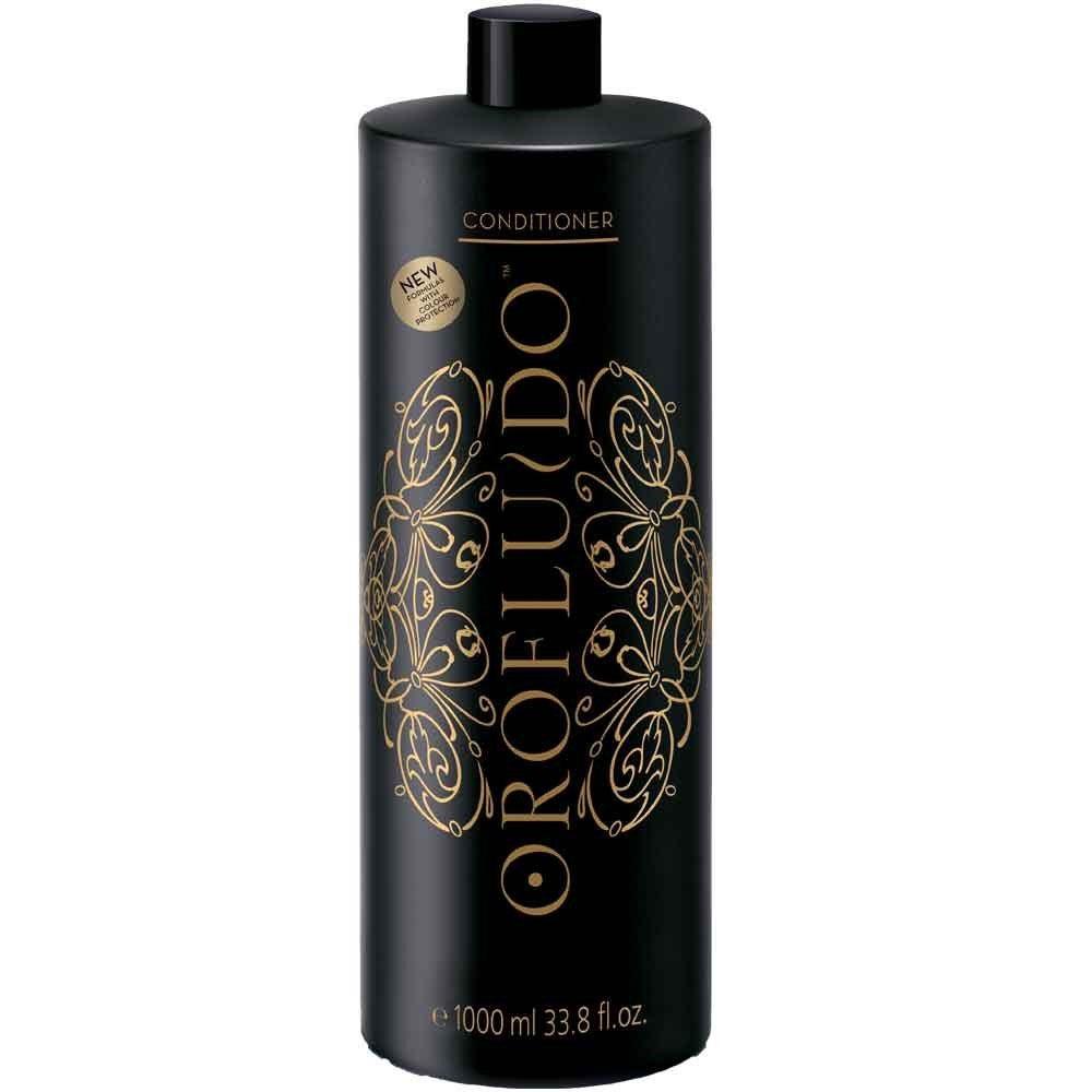 Orofluido Кондиционер для волос 1000 мл.7219942000Чтобы ваши волосы стали мягкими, шелковистыми, используйте кондиционер Orofluido. Это средство подходит для регулярного ежедневного применения, для всех типов волос. В состав кондиционера входит комплекс натуральных масел, нежно ухаживающих за волосами. Даже если ваши волосы сильно пересушены, масло арганы обязательно вернет им блеск, сделает сильными, устранит зуд, а также снимет раздражение кожи головы. Льняное масло обладает уникальным свойством придавать волосам сияние и блеск, делать их завораживающе привлекательными. Кстати, этим свойством масла пользовались с давних пор египтяне. Льняное масло насыщает волосы витамином Е, делает их послушными. Такой компонент, как масло ситника, издавна славится своей способностью повышать эластичность волос, смягчать пряди и придавать им объем. Кроме того, вы непременно оцените восхитительный аромат бальзама!