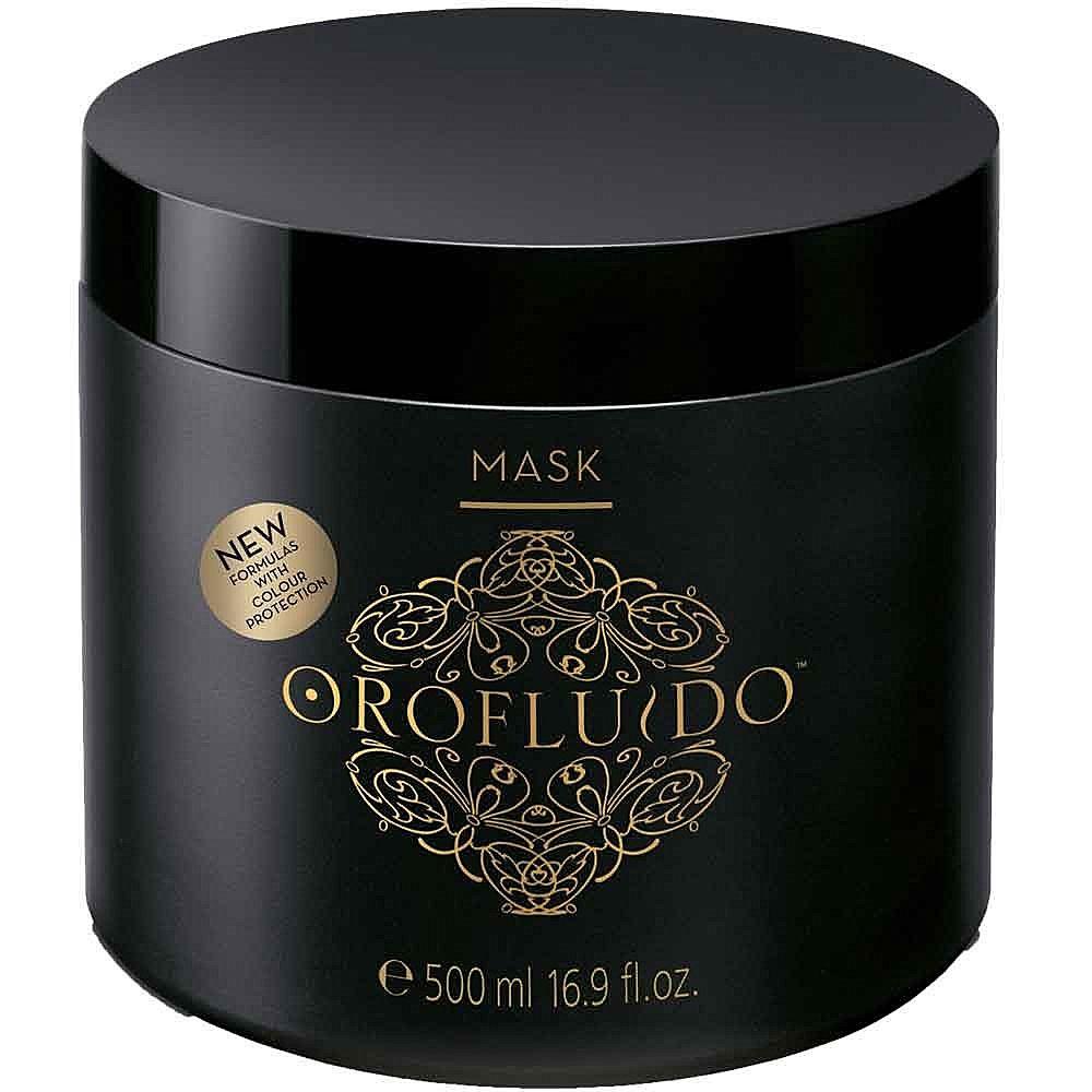 Orofluido Маска для волос 500 мл.7219945000Маска Orofluido обеспечит увлажнение вашим локонам, восстановит поврежденные волосы, вдохнет в них новую жизнь и сделает здоровыми и шелковистыми. В состав маски входят натуральные масла. Масло арганы оказывает целебное воздействие на окрашенные, поврежденные и сухие волосы, снимает зуд и раздражение кожи головы, защищает волосы от горячего воздуха и солнца. Масло ситника придает прядям объем, смягчает волосы, делает их эластичными. Льняное масло обладает особым эффектом: оно моментально придает волосам блеск, насыщая их витамином Е, запечатывает кутикулу, делая волосы гладкими. В состав средства также входят катионные компоненты, благодаря которым волосы не электризуются и буквально сияют здоровьем.