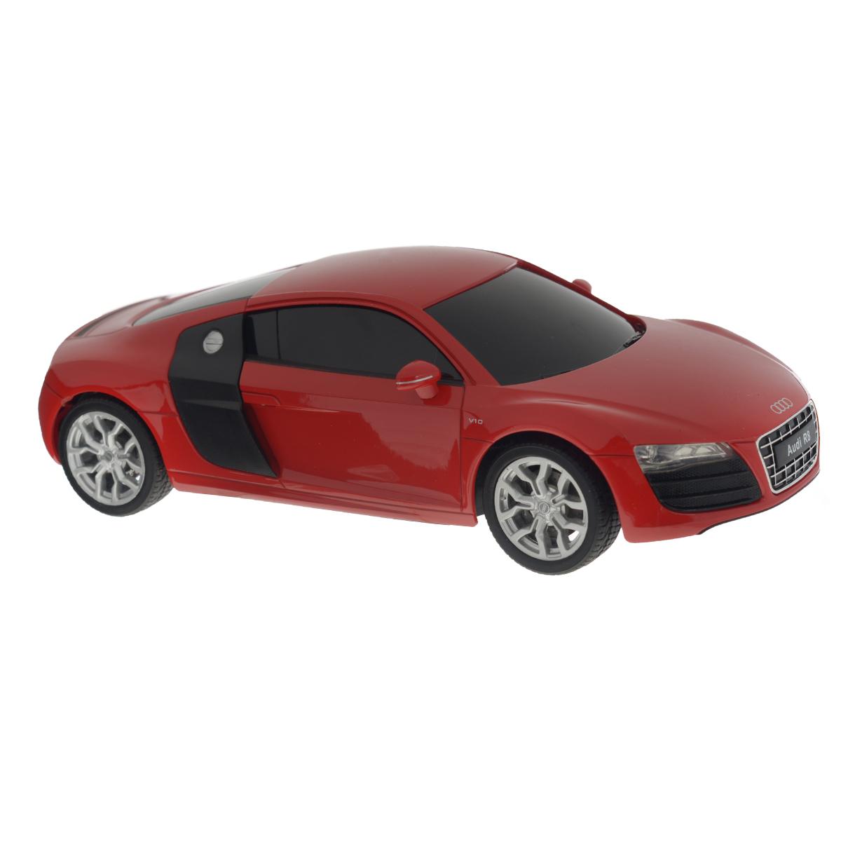 Welly Радиоуправляемая модель Audi R8 V10 цвет красный84004_красныйРадиоуправляемая модель Welly Audi R8 V10 обязательно привлечет внимание взрослого и ребенка и понравится любому, кто увлекается автомобилями. Маневренная и реалистичная уменьшенная копия Audi R8 V10 выполнена в точной детализации с настоящим автомобилем в масштабе 1/24. Управление машинкой происходит с помощью пульта. Машинка двигается вперед и назад, поворачивает направо и налево. Радиус действия пульта - 8 метров. Колеса игрушки прорезинены и обеспечивают плавный ход, машинка не портит напольное покрытие. Радиоуправляемые игрушки способствуют развитию координации движений, моторики и ловкости. Ваш ребенок часами будет играть с моделью, придумывая различные истории и устраивая соревнования. Порадуйте его таким замечательным подарком! Питание: для работы машинки - 3 батарейки напряжением 1,5V типа АА; для работы пульта - 2 батарейки напряжением 1,5V типа АА (не входят в комплект).