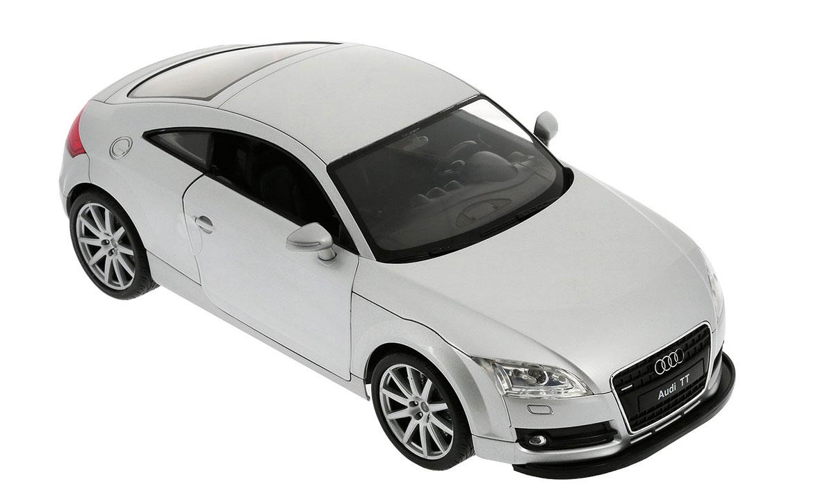 Welly Радиоуправляемая модель Audi TT Coupe82001Радиоуправляемая модель Welly Audi TT Coupe обязательно привлечет внимание взрослого и ребенка и понравится любому, кто увлекается автомобилями. Маневренная и реалистичная уменьшенная копия Audi TT Coupe выполнена в точной детализации с настоящим автомобилем в масштабе 1/12. Управление машинкой происходит с помощью пульта. Машинка двигается вперед и назад, поворачивает направо и налево. При движении загораются передние и задние фары. При помощи пульта у машинки открываются двери. Радиус действия пульта - 30 метров. Колеса игрушки прорезинены и обеспечивают плавный ход, машинка не портит напольное покрытие. Радиоуправляемые игрушки способствуют развитию координации движений, моторики и ловкости. Ваш ребенок часами будет играть с моделью, придумывая различные истории и устраивая соревнования. Порадуйте его таким замечательным подарком! Для работы машинки необходимо докупить 6 батареек напряжением 1,5V типа АА. Для работы пульта требуется 4 батарейки...