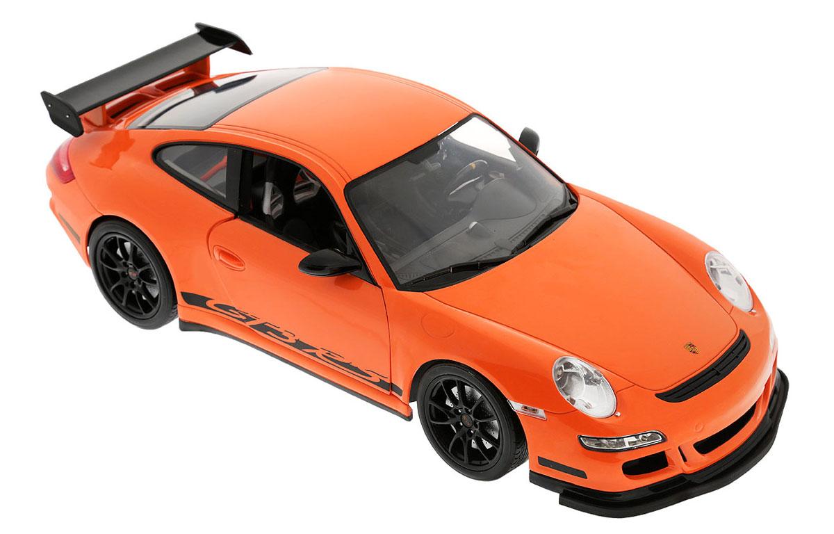 Welly Радиоуправляемая модель Porsche 911 GT3 RS82003Радиоуправляемая модель Welly Porsche 911 GT3 RS обязательно привлечет внимание взрослого и ребенка и понравится любому, кто увлекается автомобилями. Маневренная и реалистичная уменьшенная копия Porsche 911 GT3 RS выполнена в точной детализации с настоящим автомобилем в масштабе 1/12. Управление машинкой происходит с помощью пульта. Машинка двигается вперед и назад, поворачивает направо и налево. При движении загораются передние и задние фары. При помощи пульта у машинки открываются двери. Радиус действия пульта - 30 метров. Колеса игрушки прорезинены и обеспечивают плавный ход, машинка не портит напольное покрытие. Радиоуправляемые игрушки способствуют развитию координации движений, моторики и ловкости. Ваш ребенок часами будет играть с моделью, придумывая различные истории и устраивая соревнования. Порадуйте его таким замечательным подарком! Для работы машинки необходимо докупить 6 батареек напряжением 1,5V типа АА. Для работы пульта требуется 4...