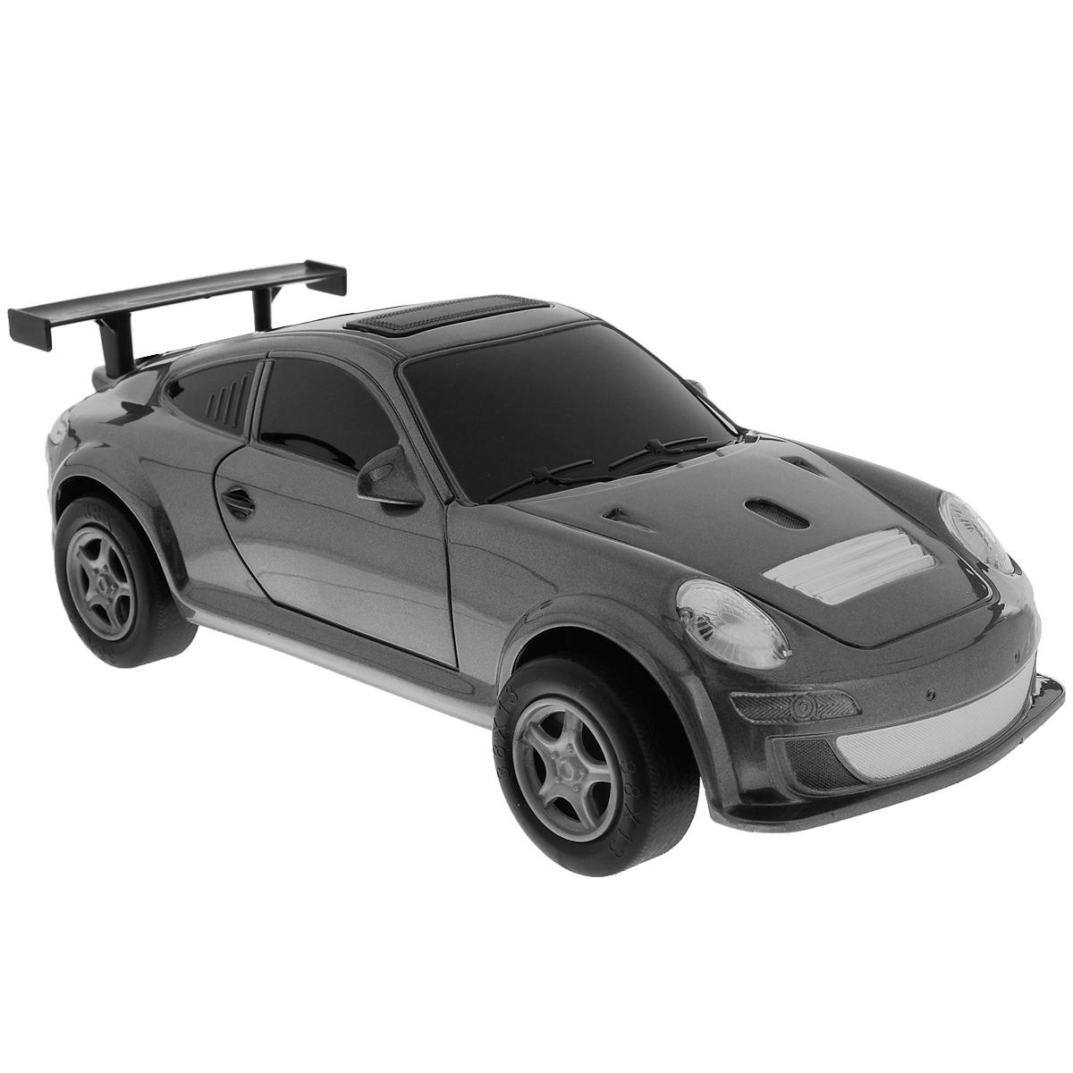 Пламенный мотор Машинка инерционная Порше цвет серый87428_серыйИгрушечный автомобиль Пламенный мотор с инерционным механизмом обязательно понравится вашему малышу. Он привлечет внимание вашего ребенка и надолго останется его любимой игрушкой. Машинка выполнена из пластмассы с элементами металла. Благодаря инерционному механизму игрушка может двигаться самостоятельно, стоит только откатить машинку назад, а затем отпустить, и она поедет вперед. Игрушка развивает концентрацию внимания, координацию движений, мелкую моторику рук, цветовое восприятие и воображение. Малыш будет в восторге от такого подарка!