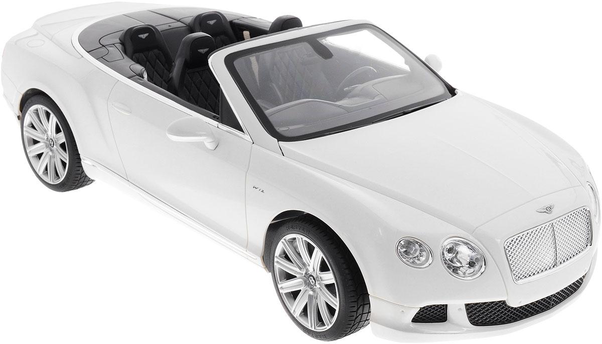 Rastar Радиоуправляемая модель Bentley Continetal GT49900Радиоуправляемая модель Rastar Bentley Continental GT Speed Convertible станет отличным подарком любому мальчику! Все дети хотят иметь в наборе своих игрушек ослепительные, невероятные и крутые автомобили на радиоуправлении. Тем более, если это автомобиль известной марки с проработкой всех деталей, удивляющий приятным качеством и видом. Одной из таких моделей является автомобиль на радиоуправлении Rastar Bentley Continetal GT Speed Convertible. Это точная копия настоящего авто в масштабе 1:12. Авто обладает неповторимым провокационным стилем и спортивным характером. Потрясающая маневренность, динамика и покладистость - отличительные качества этой модели. Возможные движения: вперед, назад, вправо, влево, остановка. Имеются световые эффекты. Пульт управления работает на частоте 40 MHz. Для работы игрушки необходимы 5 батареек типа АА (не входят в комплект). Для работы пульта управления необходима 1 батарейка напряжением 9V типа 6F22...