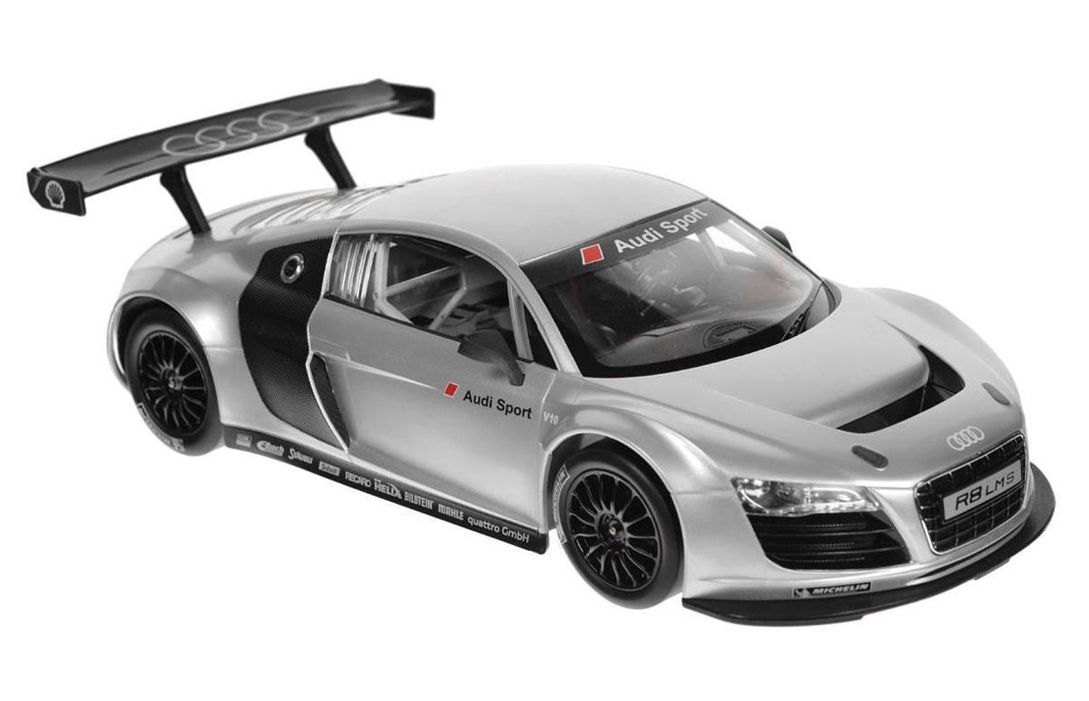 Rastar Радиоуправляемая модель Audi R8 LMS цвет серебристый47500Радиоуправляемая модель Audi R8 LMS со световыми эффектами, являющаяся точной копией настоящего автомобиля, - отличный подарок не только ребенку, но и взрослому. Автомобиль с литым корпусом изготовлен из современных прочных материалов и обладает высокой стабильностью движения, что позволяет полностью контролировать его процесс, управляя без суеты и страха сломать игрушку. Основные направления движения автомобиля: вперед-назад-влево- вправо. Движение вперед и назад сопровождается сигнальными световыми эффектами фар. В комплект входят автомобиль, пульт управления и инструкция на русском языке.Автомобиль работает от 5 батареек типа АА, пульт управления - от батарейки 9V 6F22 (не входит в комплект).