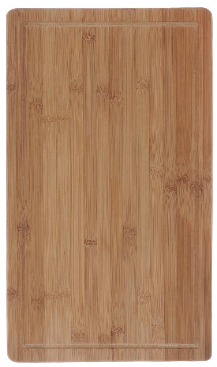Доска разделочная Kesper, на ножках, 50 х 28 х 4 см5459-1Разделочная доска Kesper изготовлена из бамбука и оснащена пластиковыми ножками. Наличие канавки по краю изделия поможет предотвратить вытекание сока от продуктов за пределы доски. Функциональные и простые в использовании, разделочные доски Kesper прекрасно впишутся в интерьер любой кухни и прослужат вам долгие годы.