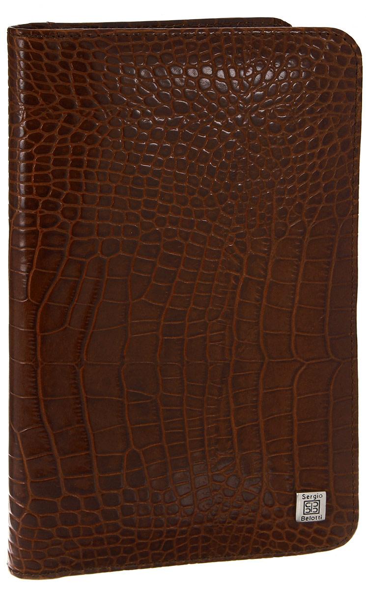 Визитница вертикальная Sergio Belotti, цвет: коричневый. 13081308 modena cognacСтильная вертикальная визитница Sergio Belotti выполнена из натуральной кожи с тиснением под рептилию. Изделие оформлено металлической фурнитурой с символикой бренда. Визитница раскладывается пополам. Внутри изделие содержит съемный блок, состоящий из 12 файлов (вмещают 36 визиток), а также два накладных кармана и два угловых кармана. Изделие поставляется в фирменной упаковке. Визитница Sergio Belotti станет отличным подарком для человека, ценящего качественные и практичные вещи.