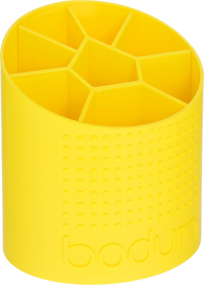 Подставка для столовых приборов Bodum Bistro, цвет: желтый, 15 х 13 х 17,5 смA11551-957-Y15Подставка для столовых приборов Bodum Bistro выполнена из высококачественного пластика, станет полезным приобретением для вашей кухни. Подставка имеет восемь отделения для разных видов столовых приборов. Изделие оформлено рельефной поверхностью. Она имеет прорезиненные фиксаторы, которые не дадут скользить на поверхности. Красивая подставка для столовых приборов украсит любую кухню. Хорошо впишется в интерьер. Не займет много места, а столовые приборы будут всегда под рукой. Размер подставки: 15 х 13 х 17,5 см.