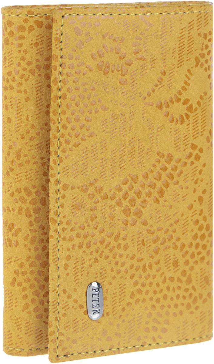 Ключница женская Petek 1855, цвет: желтый. 509.109.14509.109.14 YellowСтильная женская ключница Petek 1855 выполнена из натуральной кожи с лазерной обработкой и цветочным принтом и оформлена металлической пластиной с гравировкой бренда. Изделие закрывается на клапан с кнопкой. Внутри находится шесть металлических крючков для ключей, отделение для купюр, прорезной карман на застежке-молнии и карман с сетчатым окошечком. Ключница упакована в фирменную коробку. Этот аксессуар станет замечательным подарком человеку, ценящему качественные и практичные вещи.