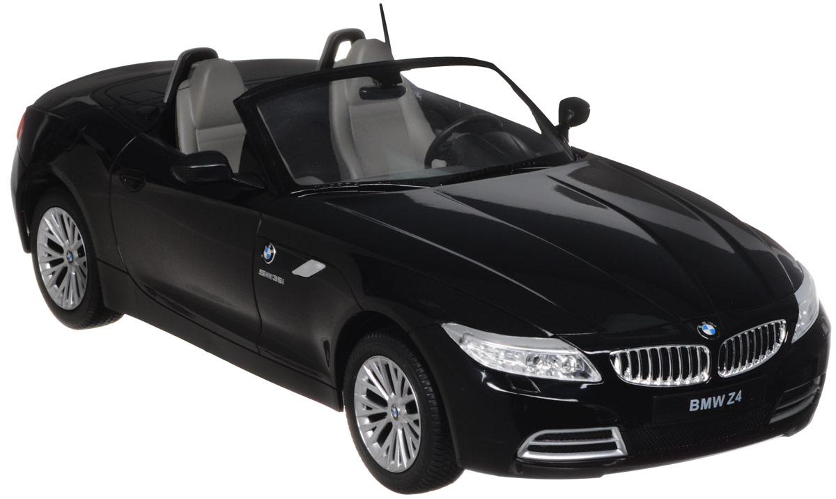Rastar Радиоуправляемая модель BMW Z4 цвет черный масштаб 1:1240300Радиоуправляемая модель Rastar BMW Z4 обязательно привлечет внимание взрослого и ребенка и понравится любому, кто увлекается автомобилями. Все дети хотят иметь в наборе своих игрушек ослепительные, невероятные и крутые автомобили на радиоуправлении. Тем более если это автомобиль известной марки с проработкой всех деталей, удивляющий приятным качеством и видом. Маневренная и реалистичная уменьшенная копия BMW Z4 выполнена в точной детализации с настоящим автомобилем в масштабе 1:12. Управление машинкой происходит с помощью удобного пульта. Автомобиль двигается вперед и назад, поворачивает направо и налево. Автомобиль изготовлен из пластика с металлическими элементами. Колеса игрушки прорезинены и обеспечивают плавный ход, машинка не портит напольное покрытие. Радиоуправляемые игрушки способствуют развитию координации движений, моторики и ловкости. Ваш ребенок часами будет играть с моделью, придумывая различные истории и устраивая соревнования. Порадуйте его...