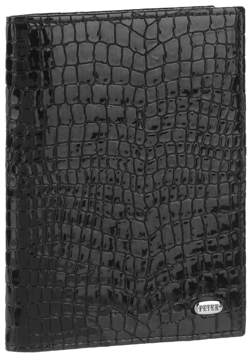 Обложка для автодокументов Petek 1855, цвет: черный. 584.091.01584.091.01 BlackСтильная обложка для автодокументов Petek 1855 выполнена из натуральной лакированной кожи с тиснением под крокодила. Изделие оформлено металлической пластиной с гравировкой бренда. Внутри имеется два боковых кармана, блок из шести прозрачных файлов из мягкого пластика, один из которых формата А5 и четыре прорезных кармана для визиток и пластиковых карт. Такая обложка не только поможет сохранить внешний вид ваших документов и защитит их от повреждений, но и станет стильным аксессуаром, идеально подходящим вашему образу.