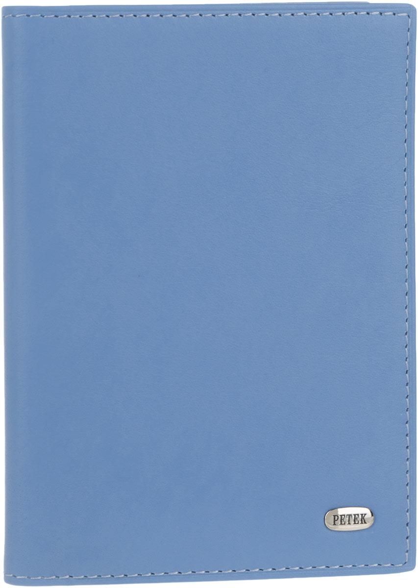Обложка для автодокументов женская Petek 1855, цвет: голубой. 584.167.74584.167.74 Violet BlueСтильная женская обложка для автодокументов Petek 1855 выполнена из натуральной кожи. Изделие оформлено металлической пластиной с гравировкой бренда. Внутри имеется два боковых кармана, блок из шести прозрачных файлов из мягкого пластика, один из которых формата А5 и четыре прорезных кармана для визиток и пластиковых карт. Такая обложка не только поможет сохранить внешний вид ваших документов и защитит их от повреждений, но и станет стильным аксессуаром, идеально подходящим вашему образу.