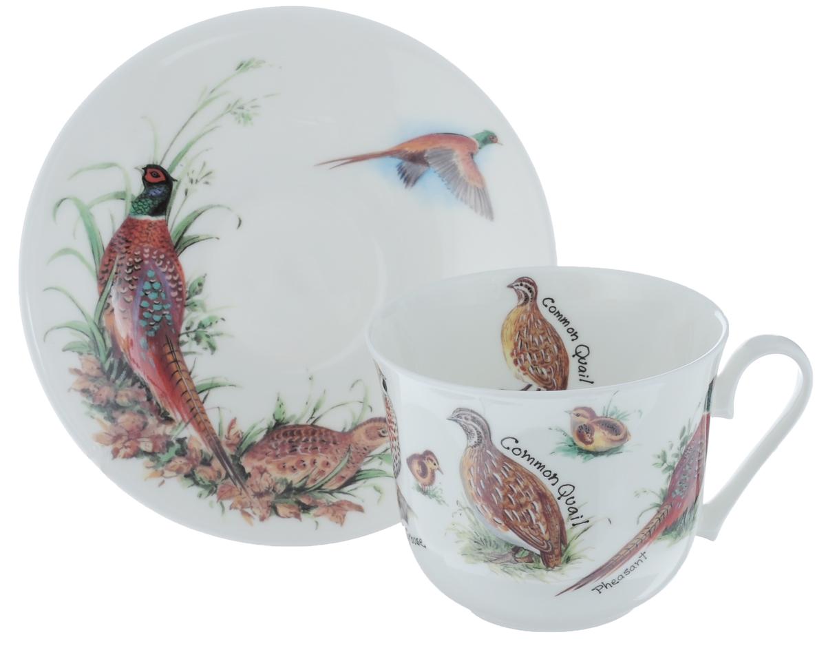 Чайная пара Roy Kirkham Птицы, 2 предметаXGAM1100Чайная пара Roy Kirkham Птицы состоит из чашки и блюдца, изготовленных из тонкостенного костяного фарфора высшего качества, отличающегося необыкновенной прочностью и небольшим весом. Изделия оформлены изображением разных птиц. Яркий дизайн, несомненно, придется вам по вкусу. Чайная пара Roy Kirkham Птицы украсит ваш кухонный стол, а также станет замечательным подарком к любому празднику. Объем чашки: 500 мл. Диаметр чашки по верхнему краю: 10,5 см. Высота чашки: 8,5 см. Диаметр блюдца: 17 см. Высота блюдца: 2,5 см.