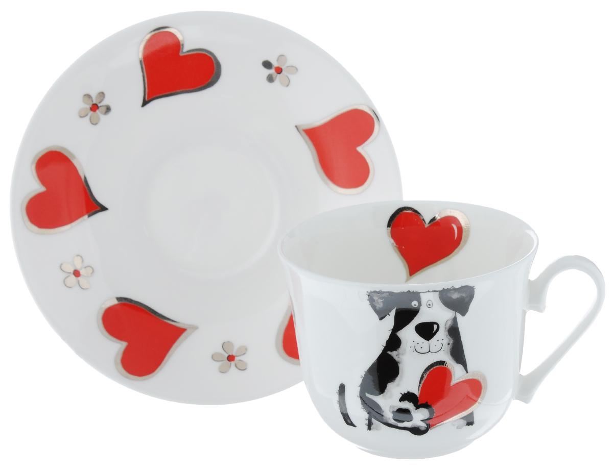Чайная пара Roy Kirkham Любимые собаки, 2 предметаXMYLOVD1100Чайная пара Roy Kirkham Любимые собаки состоит из чашки и блюдца, изготовленных из тонкостенного костяного фарфора высшего качества, отличающегося необыкновенной прочностью и небольшим весом. Изделия оформлены изображением собак и сердец. Яркий дизайн, несомненно, придется вам по вкусу. Чайная пара Roy Kirkham Любимые собаки украсит ваш кухонный стол, а также станет замечательным подарком к любому празднику. Объем чашки: 500 мл. Диаметр чашки по верхнему краю: 10,5 см. Высота чашки: 8,5 см. Диаметр блюдца: 17 см. Высота блюдца: 2,5 см.