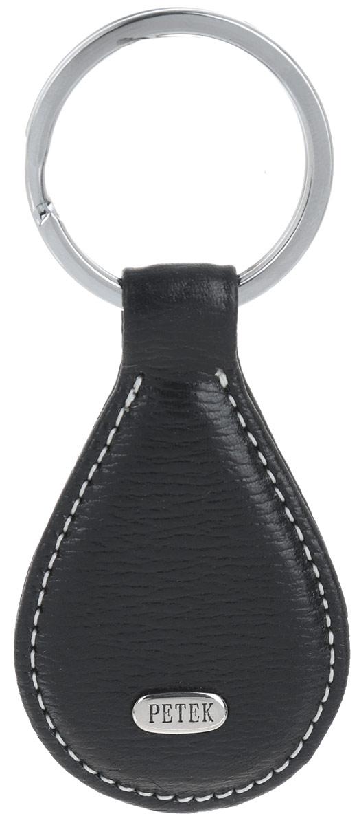 Брелок Petek 1855, цвет: черный. 529.46RU.01529.46RU.01 BlackСтильный брелок для ключей Petek 1855 выполнен из натуральной кожи. Изделие оформлено металлической пластиной с гравировкой бренда и оснащено металлическим кольцом. Брелок упакован в фирменную коробку. Такой брелок станет стильным дополнением к ключам.