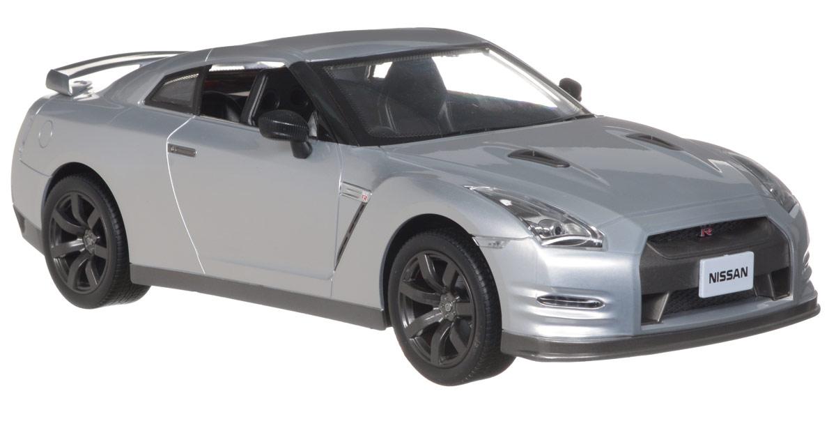 Kidztech Радиоуправляемая модель Nissan GT-R цвет серый6618-887A_grey/88071Радиоуправляемая модель Nissan GT-R стильного серебристого цвета является точной уменьшенной копией настоящего автомобиля в масштабе 1:12. Модель привлечет внимание не только ребенка, но и взрослого. Машинка при помощи пульта управления движется вперед, дает задний ход, поворачивает влево и вправо, останавливается. Фары машины светятся. Модель обладает высокой стабильностью движения, что позволяет полностью контролировать его процесс, управляя уверенно и без суеты. Такая модель станет отличным подарком не только любителю автомобилей, но и человеку, ценящему оригинальность и изысканность, а качество исполнения представит такой подарок в самом лучшем свете. Машина работает от 5 батарей типа АА (не входят в комплект), пульт управления работает от батареи напряжением 9V (не входит в комплект).