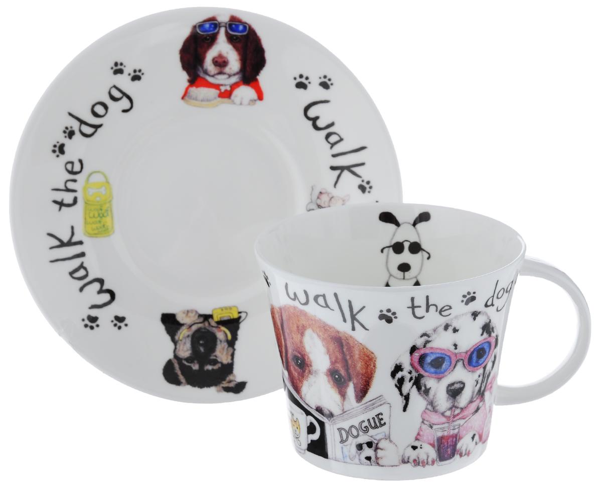 Чайная пара Roy Kirkham Собаки-модники, 2 предметаXANIDOG1110Чайная пара Roy Kirkham Собаки-модники состоит из чашки и блюдца, изготовленных из тонкостенного костяного фарфора высшего качества, отличающегося необыкновенной прочностью и небольшим весом. Изделия оформлены изображением забавных собак. Яркий дизайн, несомненно, придется вам по вкусу. Чайная пара Roy Kirkham Собаки-модники украсит ваш кухонный стол, а также станет замечательным подарком к любому празднику. Объем чашки: 500 мл. Диаметр чашки по верхнему краю: 10,5 см. Высота чашки: 8,5 см. Диаметр блюдца: 17 см. Высота блюдца: 2,5 см.