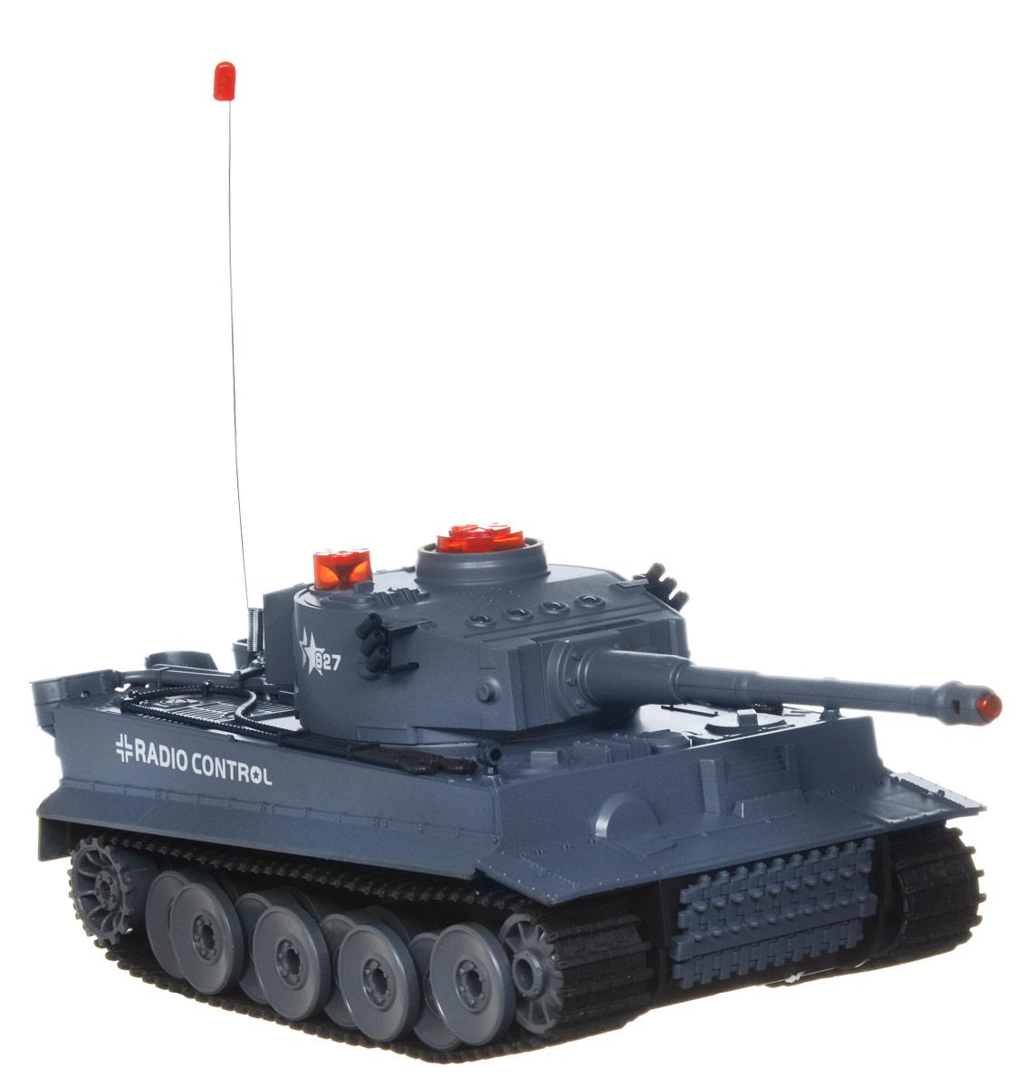 ABtoys Танк на радиоуправлении C-00058C-00058Радиоуправляемый Боевой танк понравится не только малышам, но и взрослым любителям военной техники. Игрушка выполнена из безопасного прочного пластика с элементами из металла и дополнена системой инфракрасного наведения. Танк может двигаться вправо, влево, вперед и назад, вращаться на месте. Башня танка может вращаться направо и налево на 180 градусов, а регулируемая пушка опускается и поднимается. Вверху танка имеются индикаторы жизни и питания. Радиус действия пульта управления составляет 10 метров, радиус инфракрасных выстрелов - 3 метра. Реалистичные световые и звуковые эффекты при стрельбе позволяют еще глубже окунуться в атмосферу настоящего танкового боя. Радиоуправляемые игрушки развивают многочисленные способности ребенка: мелкую моторику, пространственное мышление, реакцию и логику. Порадуйте своего ребенка таким замечательным подарком! Игрушка работает от съемного аккумулятора напряжением 7,2V с зарядным устройством (входят в комплект). ...