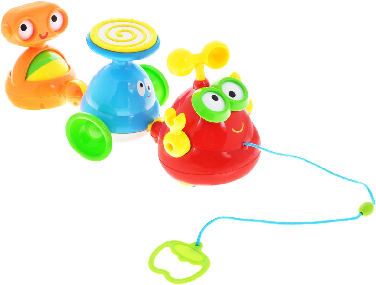 Zhorya Каталка Забавный хороводХ75548Игрушка-каталка Zhorya Забавный хоровод, выполненная из яркого пластика, несомненно, привлечет внимание ребенка. Ребенок быстрее научится ходить с такой игрушкой, ведь это так увлекательно - катить ее за собой на веревочке и слушать веселую песенку! Хоровод состоит из трех разноцветных симпатичных инопланетян. Колесики и текстильный шнурок позволят ребенку самостоятельно катать игрушку. Игрушка стимулирует двигательную активность, тренирует координацию движений, развивает воображение. Порадуйте вашего малыша таким замечательным подарком! Необходимо докупить 2 батарейки напряжением 1,5V типа АА (не входят в комплект).