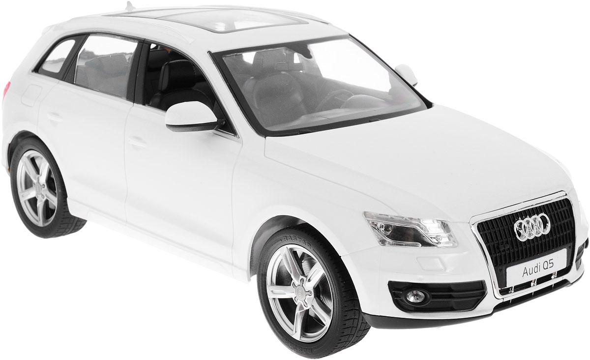 Rastar Радиоуправляемая модель Audi Q5 цвет белый масштаб 1:1438500Радиоуправляемая модель Rastar Audi Q5 станет отличным подарком любому мальчику! Все дети хотят иметь в наборе своих игрушек ослепительные, невероятные и модные автомобили на радиоуправлении. Тем более, если это автомобиль известной марки с проработкой всех деталей, удивляющий приятным качеством и видом. Одной из таких моделей является автомобиль на радиоуправлении Rastar Audi Q5. Это точная копия настоящего авто в масштабе 1:14. Авто обладает неповторимым провокационным стилем и спортивным характером. Потрясающая маневренность, динамика и покладистость - отличительные качества этой модели. Возможные движения: вперед, назад, вправо, влево, остановка. При движении загораются фары и стоп-сигналы. Машина работает от 5 батареек типа АА напряжением 1,5V, пульт работает от батарейки 9V типа Крона (не входят в комплект).