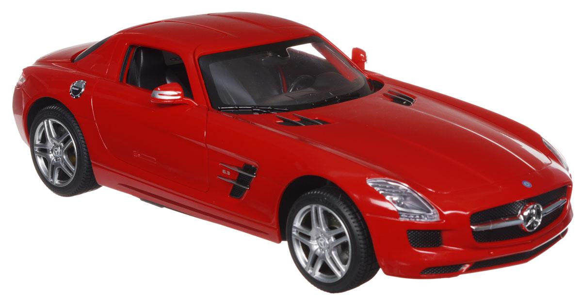 Rastar Радиоуправляемая модель Mercedes-Benz SLS AMG цвет красный масштаб 1:1447600_красныйРадиоуправляемая модель Rastar Mercedes-Benz SLS AMG обязательно привлечет внимание взрослого и ребенка и понравится любому, кто увлекается автомобилями. Все дети хотят иметь в наборе своих игрушек ослепительные, невероятные и крутые автомобили на радиоуправлении. Тем более если это автомобиль известной марки с проработкой всех деталей, удивляющий приятным качеством и видом. Маневренная и реалистичная уменьшенная копия Mercedes-Benz SLS AMG выполнена в точной детализации с настоящим автомобилем в масштабе 1:14. Управление машинкой происходит с помощью удобного пульта. Автомобиль двигается вперед и назад, поворачивает направо и налево. Автомобиль изготовлен из пластика с металлическими элементами. У модели открываются двери, при движении загораются фары. Колеса игрушки прорезинены и обеспечивают плавный ход, машинка не портит напольное покрытие. Радиоуправляемые игрушки способствуют развитию координации движений, моторики и ловкости. Ваш ребенок часами будет...