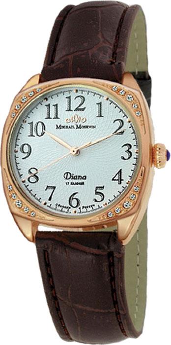 Часы женские наручные Mikhail Moskvin Диана, цвет: коричневый, золотой, белый. 595-8-2595-8-2Элегантные женские часы Mikhail Moskvin Диана изготовлены из нержавеющей стали, натуральной кожи и минерального стекла. Корпус часов украшен стразами, циферблат дополнен символикой бренда. Изделие имеет степень влагозащиты равную 3 Bar, а также дополнено устойчивым к царапинам минеральным стеклом. Ремешок часов украшен тиснением под рептилию, оснащен классической пряжкой, которая позволит с легкостью снимать и надевать изделие. Часы поставляются в фирменной упаковке. Часы Mikhail Moskvin Диана подчеркнут изящность женской руки и отменное чувство стиля у их обладательницы.