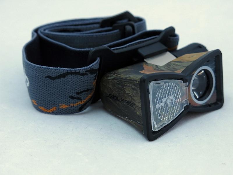 Фонарь светодиодный Solaris M20, налобный, цвет: камуфляжS2103Многоцелевой высококачественный налобный светодиодный фонарь Solaris M20 - компактный и легкий, с перекидной шторкой диффузора и клипсой для крепления. Корпус фонаря выполнен из противоударного ABS пластика. Водонепроницаемый — стандарт IPX8. Встроенный стабилизатор напряжения. Фонарь снабжен современным светодиодом CREE XP-E Q5 (США). Особенности: - рефлектор фонаря снабжен перекидной шторкой диффузора. При установке шторки на рефлектор фонарь эффективно рассеивает свет для работы на ближней дистанции. - фонарь можно снять с оголовного ремня и прикрепить с помощью клипсы (в комплекте) на лямку рюкзака, карман одежды, брючный ремень и т.п. Также можно использовать фонарь без оголовного ремня - в качестве карманного фонаря для повседневного ношения. Особенности конструкции: - перекидная шторка диффузора; - съемная клипса; - четыре режима работы фонаря: High (полная мощность), Medium (средний режим),...