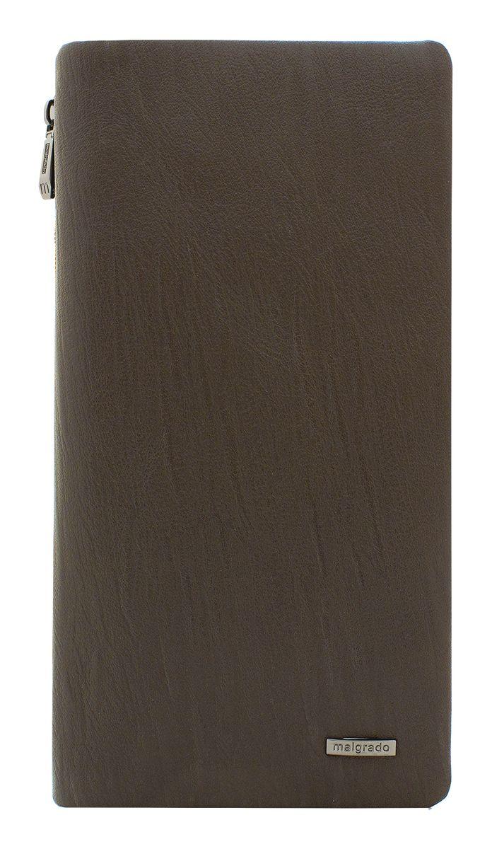 Портмоне мужское Malgrado, цвет: коричневый. 73039М-5260173039М-52601 BrownСтильное портмоне Malgrado выполнено из высококачественной натуральной кожи, оформлено металлической фурнитурой с символикой бренда. Портмоне закрывается клапаном на кнопку. Внутри изделия расположены три отделения для купюр, один вшитый потайной карман, двенадцать карманов для кредитных карт. Портмоне содержит блок для мелких документов, который закрывается на кнопку. Снаружи, в задней стенке портмоне, расположен вшитый продольный карман на молнии. Портмоне упаковано в коробку из плотного картона с логотипом фирмы. Это элегантное портмоне непременно подойдет к вашему образу и порадует простотой, стилем и функциональностью.