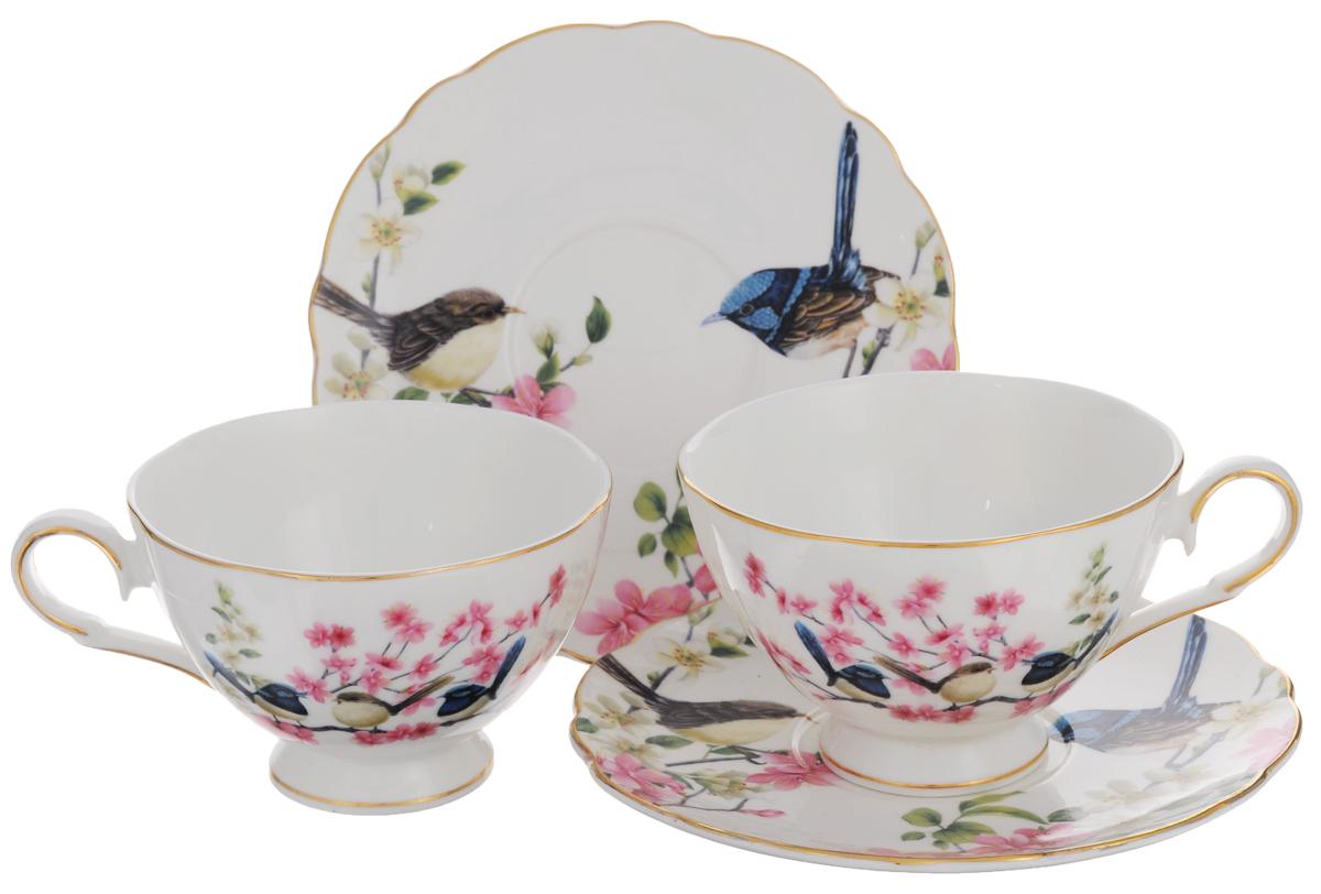 Набор чайный Elan Gallery Райские птички, 4 предмета420024Набор чайный Elan Gallery Райские птички состоит из двух чашек и двух блюдец, выполненных из высококачественной керамики. Изделия оформлены изящным рисунком цветов и птиц. Изящный набор эффектно украсит стол к чаепитию и порадует вас функциональностью и ярким дизайном. Объем чашки: 220 мл. Диаметр чашки (по верхнему краю): 10 см. Высота чашки: 7 см. Диаметр блюдца: 15 см.